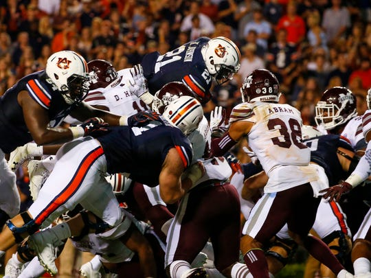 Auburn running back Kerryon Johnson (21) dives over the top for a touchdown in an NCAA college football game against Mississippi State, Saturday, Sept. 30, 2017, in Auburn, Ala. (AP Photo/Butch Dill)