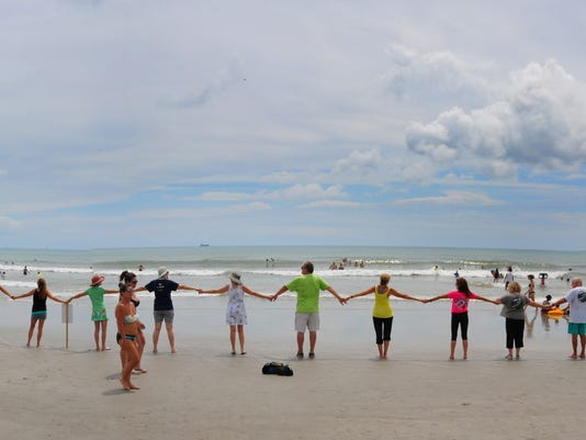 Hands across the Sand