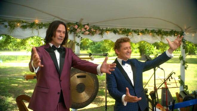 """Keanu Reeves, left, and Alex Winter in """"Bill & Ted Face The Music."""""""