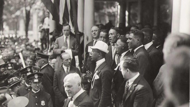 A delegation from a Black Baptist convention visits the Marion home of Warren G. Harding to show its support for his 1920 presidential campaign. In office, Harding repeatedly addressed racial issues.