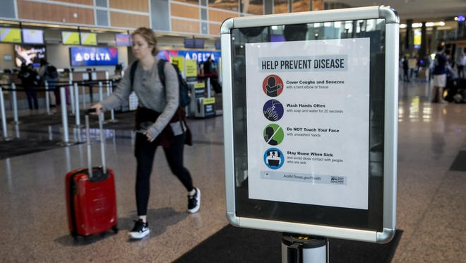 A sign from Austin Public Health asks travelers to help prevent disease  at Austin-Bergstrom International Airport in March.