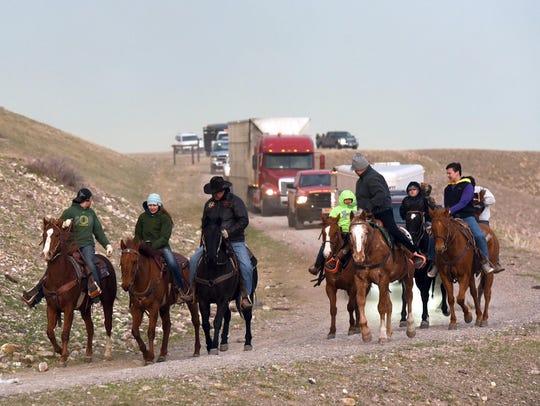 In April, Blackfeet riders escort the tractor-trailer