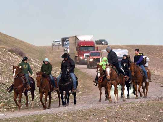 In April, Blackfeet riders escort the tractor-trailer carrying 88 bison from Elk Island National Park in Alberta, Canada, to be released east of Browning on the Blackfeet Indian Reservation. Now the tribe hopes to move those bison to the Badger-Two Medicine area in Helena-Lewis and Clark National Forest.