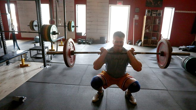 Maxx Nowitzke of Weston works out at Wausau CrossFit, Monday, April 13, 2015. Nowitzke will be one of the competitors in the gym's Festivus Games on April 18, 2015.