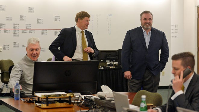 From left, Green Bay Packers general manager Ted Thompson, president Mark Murphy, head coach Mike McCarthy and director of player personnel Eliot Wolf work inside the war room during the NFL Draft at Lambeau Field on Thursday, April 30, 2015. Evan Siegle/Press-Gazette Media