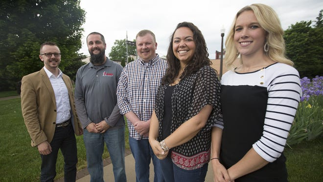 Members of the Current - Wisconsin Rapids young professionals group, Kristopher Gash, Zach Coleman, Keith Wilkes, Jenna Moran, and Briel Kohl pose for a portrait in downtown Wisconsin Rapids May 27, 2016.