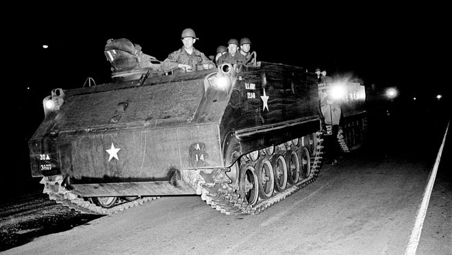 The armored personnel carriers of the Tennessee National Guard move in to seal off North Nashville after midnight April 5, 1968. The troops were called at the request of Metro Mayor Beverly Briley after rock throwing began about 8 p.m. and escalated into gunfire and scattered looting after the assassination of Martin Luther King Jr. in Memphis.