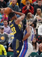 Indiana Pacers center Myles Turner (33) is guarded