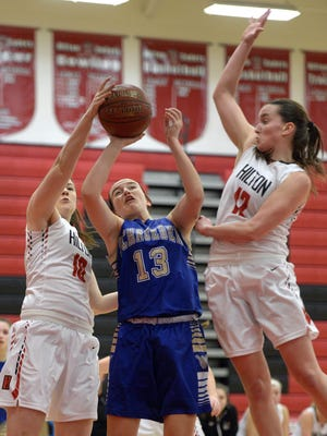 Webster Schroeder's Emily Willis-Nersinger, center, tries to split the defense of Hilton's Alyssa Juergens, right, and Meghan Schiano during a regular season game at Hilton High School on Monday, Jan. 23, 2017.