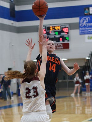 Beech's Jana Claire Swafford shoots over Station Camp's Peyton Strickland in lebanon, TN on Mon. Feb. 20, 2017.