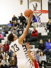 Notre Dame's Derrick Stark goes up for a layup during the Crusaders' victory over Troy in a boys Regional Division I game Tuesday at the Josh Palmer tournament at Elmira High School.