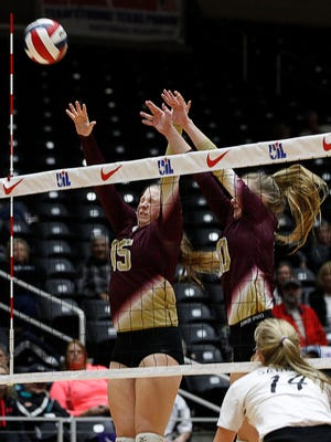 Tuloso-Midway's Hadleigh Hight (15) and Kelsi Luckenbach (10) go up for a block against Amarillo High in a Class 5A volleyball state semifinal at the Curtis Culwell Center in Garland, Texas on Friday, Nov. 18, 2016.