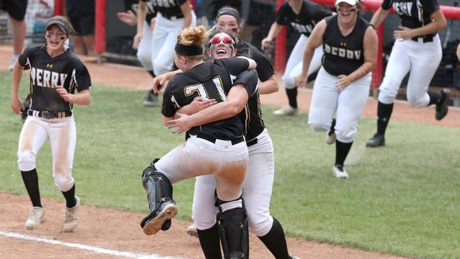 Perry's Gia Durieux (31) and Payton Gottshall (glasses) leap into each others arms while their teammates race onto the field after defeating Lakota West 11-1 during their Division I state championship game at Firestone Stadium in Akron on Saturday, June 2, 2018.