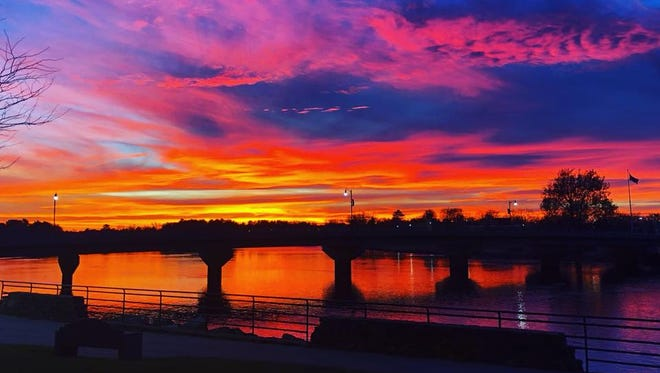 Sunset photographed over downtown Wisconsin Rapids, Wisconsin, from Veterans Memorial Park on Monday, Nov. 27, 2017.