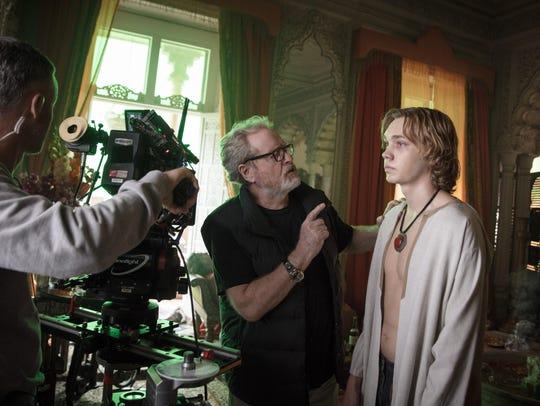 Director Ridley Scott (center) with Charlie Plummer