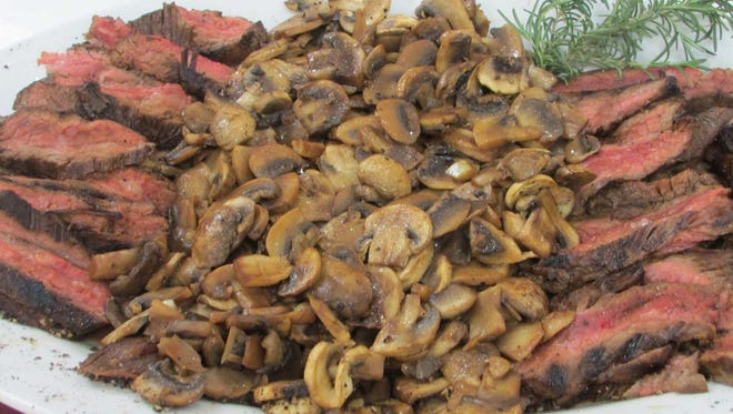 Grilled Flank Steak With Sauteed Wild Mushrooms.