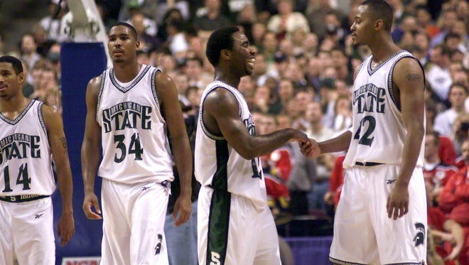 Charlie Bell, Andre Hutson, Mateen Cleaves and Morris Peterson, left to right, celebrate the Spartans' come-from-behind NCAA regional final victory over Iowa State Saturday.