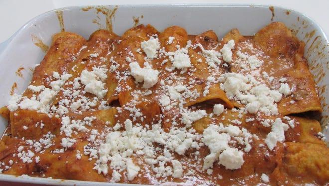 Roasted Chicken & Mushroom Enchiladas With Ancho Chili Cream Sauce.