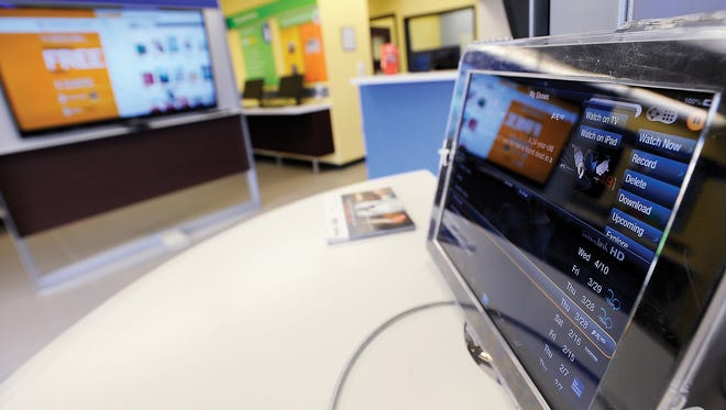 A display in the lobby of the SuddenLink office in Nacogdoches, Texas in 2013. Suddenlink is being bought by Europe-based Altice for $9.1 billion.  (AP Photo/The Daily Sentinel, Andrew D. Brosig) MANDATORY CREDIT ORG XMIT: TXNAC102
