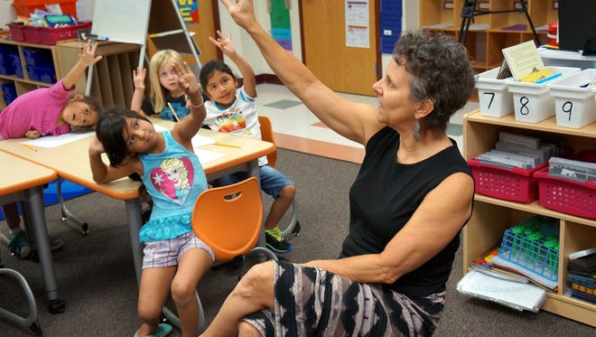Debra Knapp, professor and director of dance at the NMSU College of Education's Department of Kinesiology and Dance, helped kindergarten students at Fairacres Elementary learn how to write the alphabet Wednesday, Sept. 9, 2015, as part of the MILK, or Methods in Learning Kinesthetically, program.