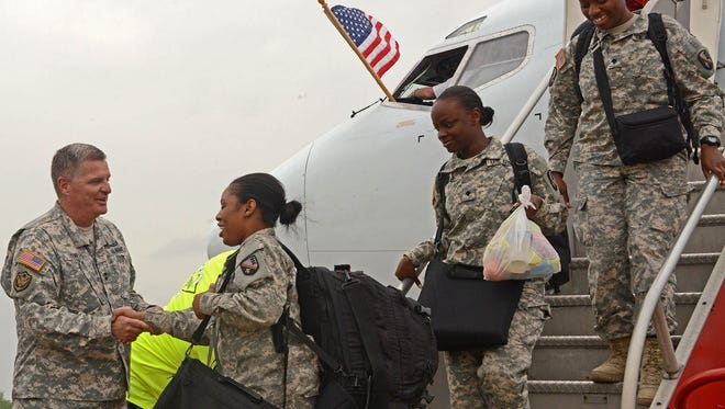 Maj. Gen. Glenn H. Curtis, the adjutant general of the Louisiana National Guard, welcomes home members of the 528th Engineer Battalion, 225th Engineer Brigade, from a year-long deployment to Kuwait on April 25.