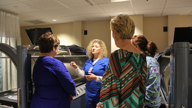 Kimberly Landsberger, RN, Lead Hyperbaric Technician and Safety Director for the Wound Healing Center, talks to guests about the new hyperbaric chambers.