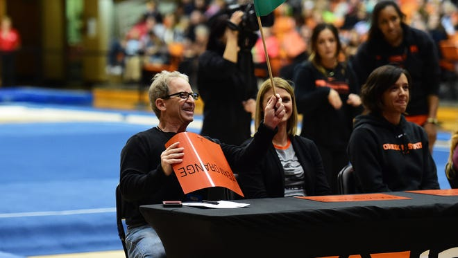 Statesman Journal reporter Gary Horowitz (left), former OSU all-American gymnast Jami (Lanz) Bressler (center), and OSU women's golf team assistant coach Dawn Shockley during the Orange & Black Exhibition on Nov. 19, 2015 at Gill Coliseum.