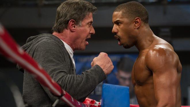 Rocky Balboa trains Apollo Creed's son, Adonis.