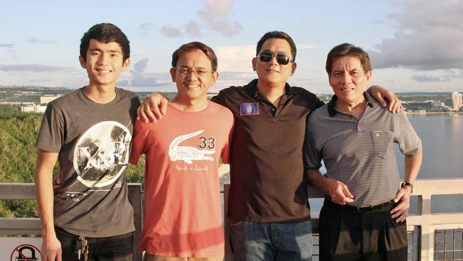 From left, Jed Caluag, Philippine Grandmaster Darwin Laylo, Noly Caluag and Eugene Torre pose for a photograph at Two Lovers Point.