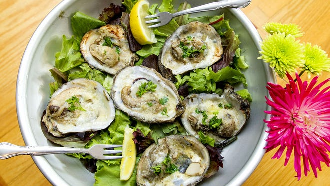 Mike McLaughlin/Correspondent Charbroiled Oysters, a recipe brought back directly from Jesse Dedreux?s time down South. Charbroiled Oysters in Romano her butter at the F-Cove Restaurant.