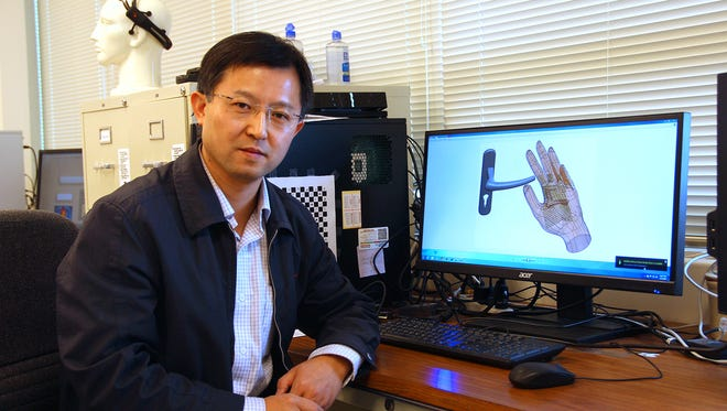 Yantao Shen, assistant professor in the Department of Electrical and Biomedical Engineering, is developing a hand-worn robotic device that will help millions of blind and visually impaired people navigate past movable obstacles or assist in their ability to pre-locate, pre-sense and grasp an object.