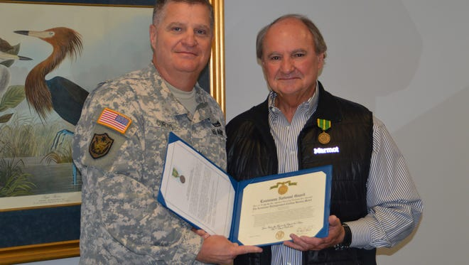 Louisiana State Senator Robert R. Adley receives the Louisiana Distinguished Civilian Service Medal from Maj. Gen. Glenn H. Curtis, adjutant general of the Louisiana National Guard, during a ceremony at the Louisiana State Capitol Building in Baton Rouge, La., Dec. 2, 2015. The medal is awarded to civilians who have rendered exceptionally meritorious service in furthering the security and welfare of the State of Louisiana