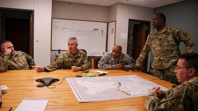Lt. Col. Larry Benton, deputy brigade commander of the 225th Engineer Brigade, along with other members of the brigade staff brief the battalions of their missions in response to the Mississippi River flooding during a conference call on Jan. 5. The brigade has been tasked with helping with levee patrols and providing equipment in response to the flooding of the Mississippi River.