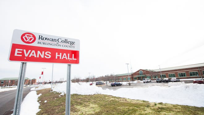 A new sign outside a building at Rowan College at Burlington County indicates its renaming in honor of first president N.Dean Evans.