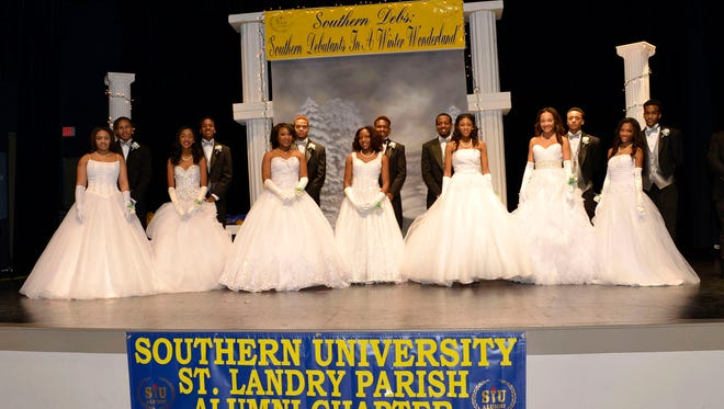 Debutantes line up on stage at last year's Southern University St. Landry Parish Alumni Chapter debutante cotillion. This year's event is scheduled for Saturday.