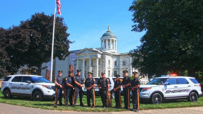 Shown left to right from the Somerset County Sheriff's Office are Sgt. Robert Peschel, Officer Ahmed Mackey, Officer Michael DeRosa, Sheriff Frank Provenzano, Officer Albert Bauer with K9 Diesel, Officer Karissa Hahn, Capt. Tim Pino and Lt. Steve SanAntonio.
