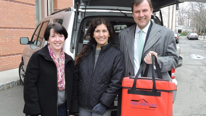 Meals on Wheels volunteers Maureen O'Rourke of Chatham and Christine Melendez of Summit, and New Jersey State Senator Tom Kean, Jr. kick-off 'March for Meals'