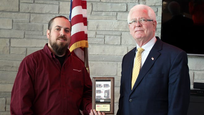 Matt Rose, left, veteran, coordinator of campus safety and adviser for the Student Veterans Organization, presented the Veteran of the Month award to Wayne Buteyn, on Feb. 11 during a ceremony held in Marian University's coffeehouse.