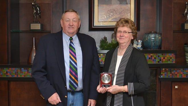 "Rick Bovre, Fond du Lac, presenting Wisconsin Holstein Association Distinguished Service Award to Saloah Hageman, Fond du Lac, in honor of her late husband, William ""Bill"" Hageman."