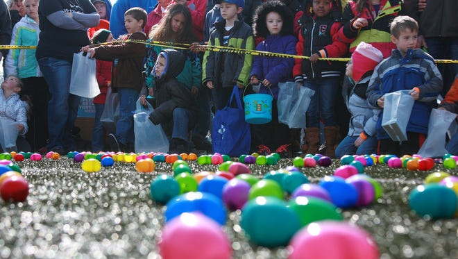 Kids await their chance to gather easter eggs at Harper Creek High School's Football Field Saturday morning