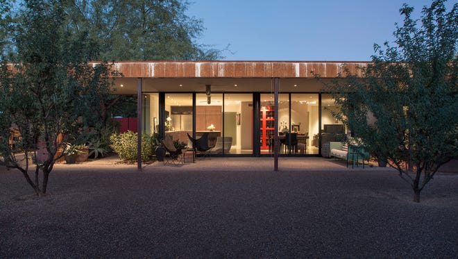 This remodeled Phoenix home on the May 21 Dwell Home Tour, features a 24-foot span of telescoping glass doors.