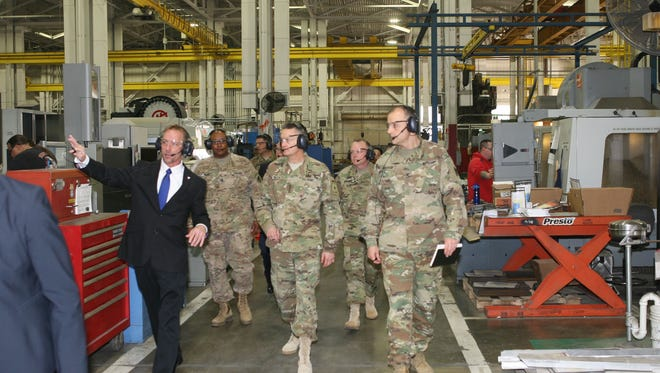 "The Ground Systems Readiness Facility at Letterkenny Army Depot was showcased as part of the Vice Chief of Staff Gen. Dan Allyn's visit to an ""organic industrial base"" depot on March 24. The depot's Vertical Machine Center, a computer numerical controlled machine, is in the background."