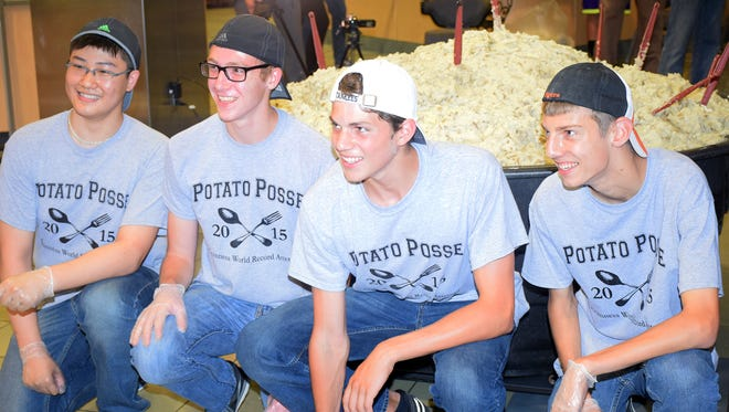 From left, Jason Lin, Tyler Hubeny, Evan Armstrong and Colin Stockdale with their record-breaking serving of mashed potatoes.