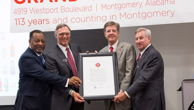 """Montgomery County Commission Chairman Elton N. Dean Sr., far left, and Montgomery Mayor Todd Strange, far right, present a city-county proclamation naming May 10 """"Coca-Cola Day."""" John H. Sherman, center, left, chief executive office, Coca-Cola Bottling Company United, and Claude B. Nielsen, center, right, chairman of the board, Coca-Cola Bottling Company United, accept the proclamation."""