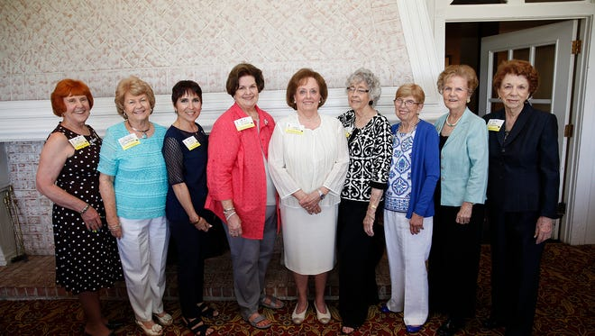 Jane Banister, from left, Mayre Sue Overstreet, Bonnie Guinn, Marilyn Cromeans, President Glenell Johnson, Andra Crossland, Anne Rettig, Betty McDonald and Betty Wilkinson