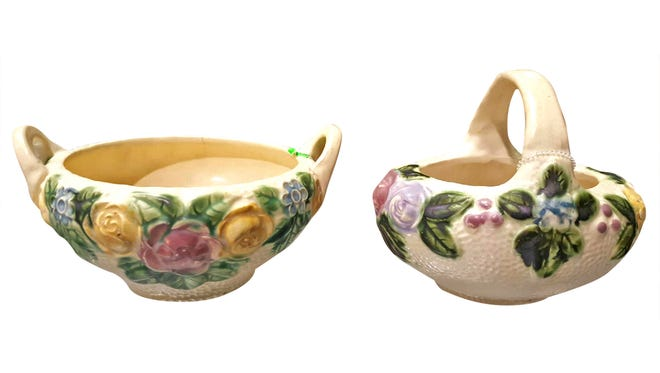 Sold at auction as a set for $110, these Roseville pottery pieces feature an earlier Rozane pattern.