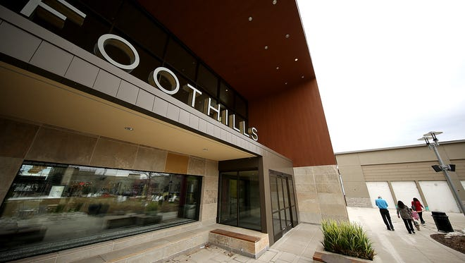 Shoppers walk out of the redeveloped Foothills shopping center in this file photo.