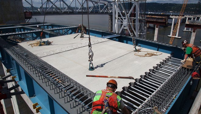 Crews install the road deck over the new Tappan Zee Bridge's main span girders.