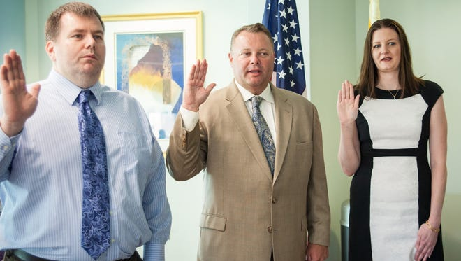 Kevin Wright (left), Chris Brown and Linda Hughes were recently welcomed as trustees at RCBC.