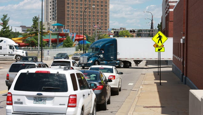 A semi-truck backs in to the loading dock at Graphic Packaging International, Inc. on Capital Avenue SW and blocks all four lanes of traffic Monday afternoon.
